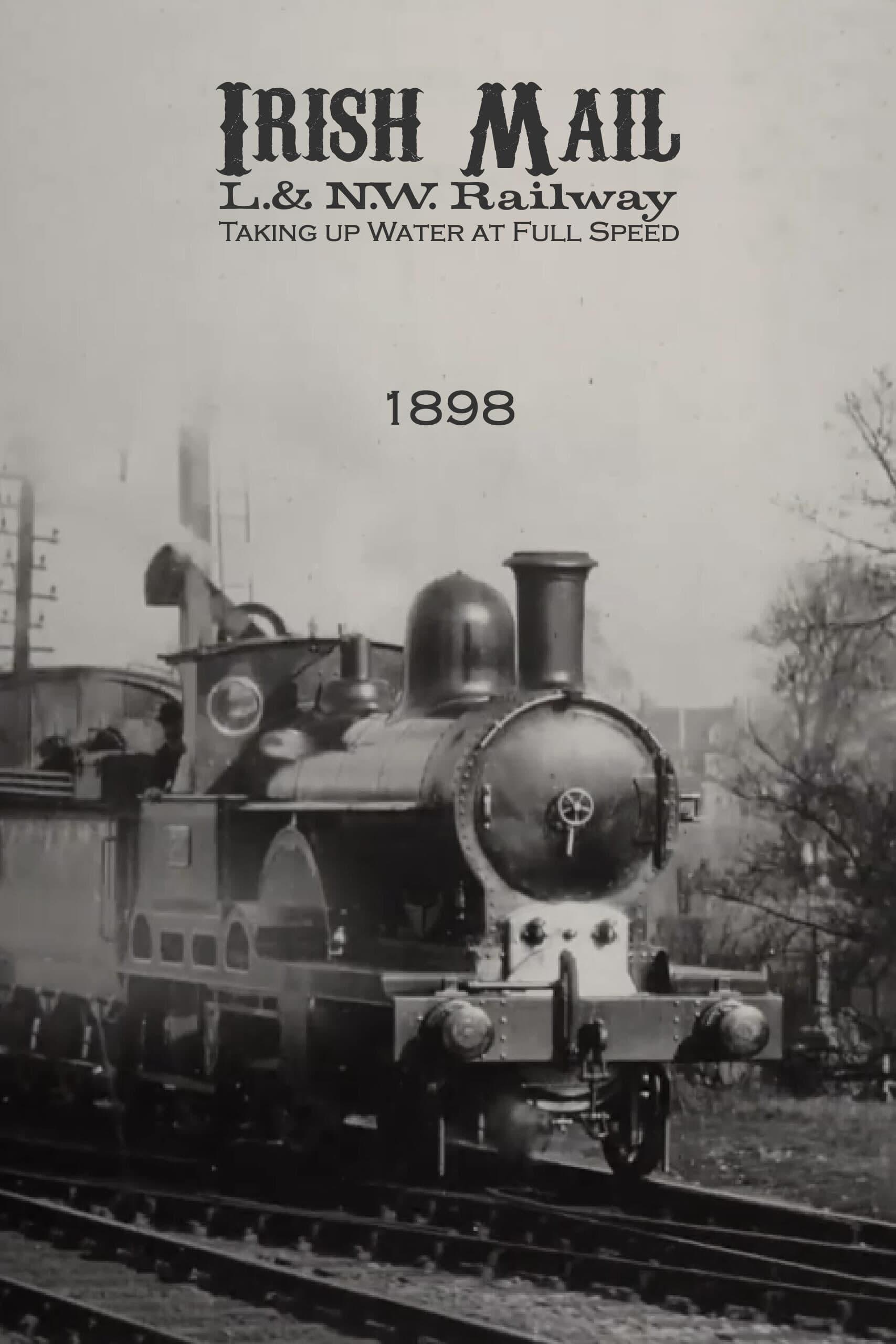 Irish Mail – L.& N.W. Railway – Taking up Water at Full Speed